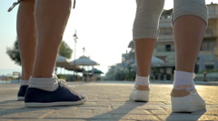 Two people running on the pavement Stock Footage