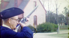 1964: Yankee doodle revolutionary era reenactor fires black powder rifle gun. - stock footage