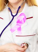 Doctor with pink cancer ribbon aids symbol on chest Kuvituskuvat