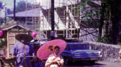 1964: Japanese style parade man pulling traditional merchant cart. Stock Footage