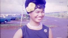 1964: Beehive hairdo happy Asian woman smiles flower in hair. Stock Footage