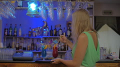 Waitress in the Bar Lighting Bengal Fires in Cocktail Glasses Stock Footage