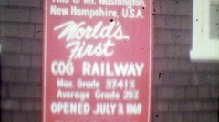 1964: World's 1st Cog Railway sign steam train intersection. Stock Footage
