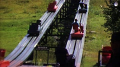 1964: Single chair amusement gentle roller coaster type transporter ride. - stock footage
