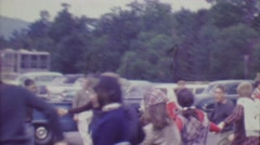 1964: Teenagers playing ring around the rosey game at Cog Railroad station. - stock footage