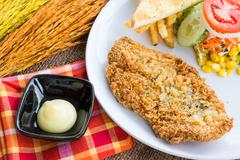 Steak fish dolly wite salad withFrench fries on sack background - stock photo