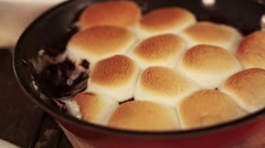 Roasted marshmallow on pan plate. Stuffed chocolate inside serving with biscuit - stock footage