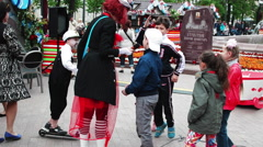 Clown Playing With the Children at the Fair Stock Footage