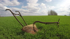 Old rusty plow in the field, time lapse 4K Stock Footage