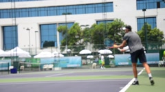 Blurred motion of people playing tennis in race championship Stock Footage