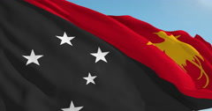 Beautiful looping flag blowing in wind: Papua New Guinea - stock footage