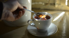 Stir in a cup of tea with a spoon Stock Footage