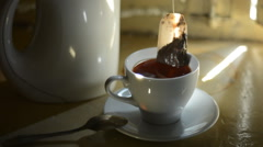 To take out a paper tea bag from the cup - stock footage