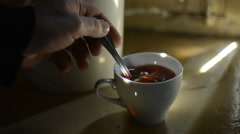 Cup of hot tea on a background of teapot - stock footage