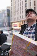 Hipster traveler young man with in a urban scene Stock Photos