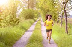 Active healthy young woman enjoying a morning run Stock Photos