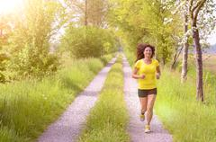 Active healthy young woman enjoying a morning run - stock photo