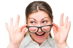 Surprised woman lowered her glasses face close-up isolated - stock photo