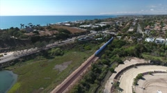 Aerial View of train passing behind Del Mar Racetrack Stock Footage