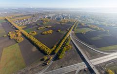 Aerial road interchange, viaduct. Crossroads view parking lots, bridges. Copter - stock photo