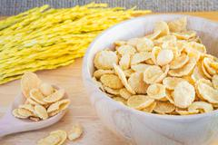 Cornflakes and yellow rice with sack or tablecloth background Stock Photos