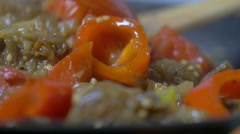 Vegetable stew stirring with wooden spoon in pan - stock footage