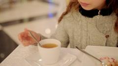 Little beautiful girl drinking tea Stock Footage
