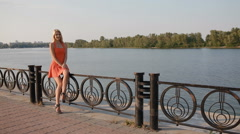 Woman take a rest on embankment Stock Footage