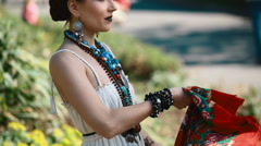 Young female model in mexican dress posing outdoor - stock footage