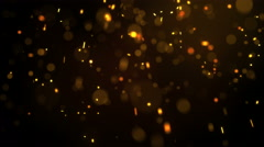 Fiery glowing particles falling down seamless loop 4k (4096x2304) Stock Footage