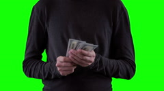Hands with money, showing dollars on chromakey - stock footage