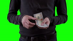 Hands with money, counting dollars on chromakey - stock footage