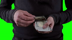 Hands with money, showing dollars on chromakey. Close up - stock footage