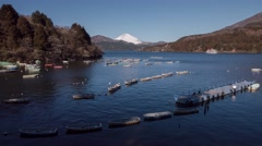 Time-lapse footage of the sky over Mount Fuji and rental boats from Lake Ashi, Stock Footage