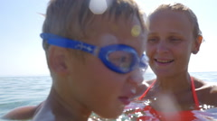 Little boy diving in the sea Stock Footage