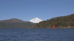 View of Mount Fuji and Hakone shrine gate from Lake Ashi on a Winter morning, Stock Footage