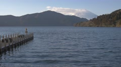 View of Mount Fuji and boat pier at Lake Ashi, Kanagawa Prefecture, Japan Stock Footage