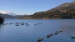 View of Mount Fuji and boats at Lake Ashi, Kanagawa Prefecture, Japan Stock Footage