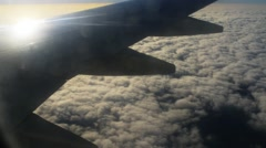 Plane flies over thick white clouds Stock Footage