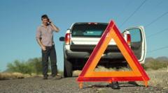 Truck Broken Down Emergency Triangle Man on Phone - stock footage