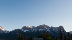 4K Time lapse pan shot 3 Sisters Mountains sunset Canmore Stock Footage