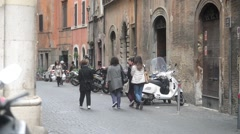 People walk through the narrow streets of Rome Italy Stock Footage