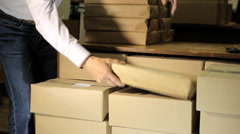 Package stack of books in the library - stock footage
