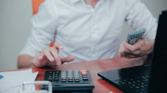 Businessman counting dollars and checking financial results Stock Footage