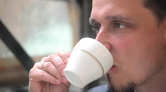 Rome, Italy. Man drinking a coffee while sitting on a cozy cafe Stock Footage