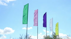 Colorful flags fluttering in the wind Stock Footage