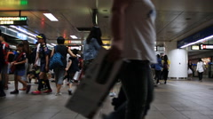 Time lapse of passengers getting off and on subway train and using escalators Stock Footage