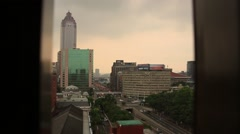 Sunset view of buildings and traffic around Taipei main train station Stock Footage