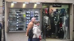 Rome, Italy. Tourists walk along the shop windows Stock Footage
