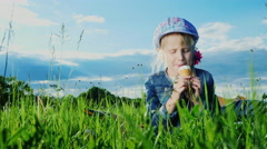 Funny girl 5 years old eat ice cream in the park Stock Footage